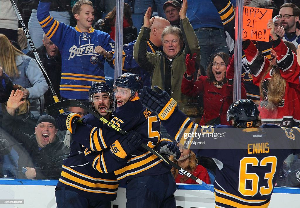 Matt Moulson of the Buffalo Sabres celebrates his game winning goal with teammates Rasmus Ristolainen and Tyler Ennis against the Montreal Canadiens...