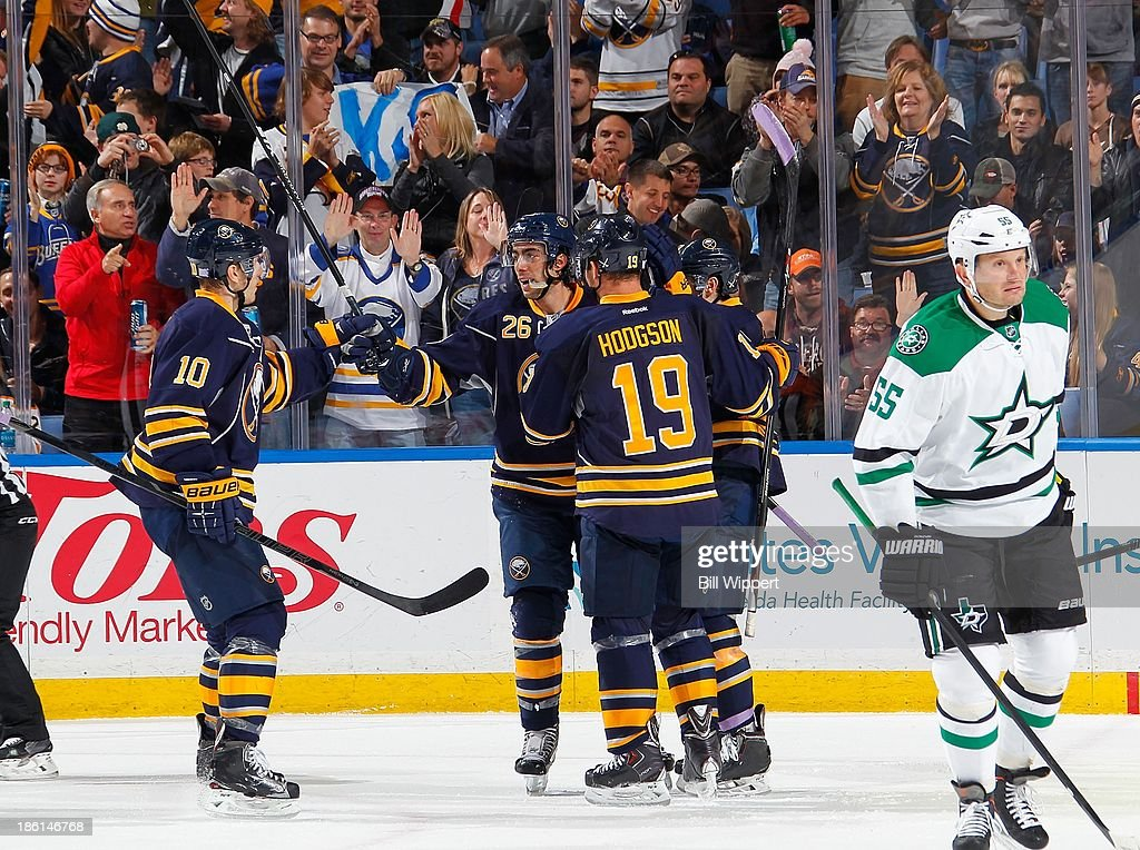 Matt Moulson #26 of the Buffalo Sabres celebrates his second period goal against the Dallas Stars with teammates Christian Ehrhoff #10 and Cody Hodgson #1 on October 28, 2013 at the First Niagara Center in Buffalo, New York.