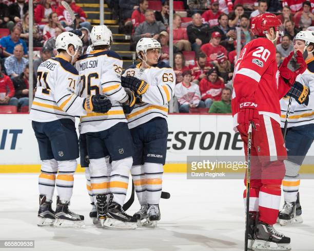 Matt Moulson of the Buffalo Sabres celebrates his second period goal with teammates Evan Rodrigues and Tyler Ennis in front of Drew Miller of the...