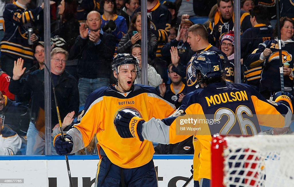 <a gi-track='captionPersonalityLinkClicked' href=/galleries/search?phrase=Matt+Moulson&family=editorial&specificpeople=3365493 ng-click='$event.stopPropagation()'>Matt Moulson</a> #26 of the Buffalo Sabres celebrates his third period goal with <a gi-track='captionPersonalityLinkClicked' href=/galleries/search?phrase=Zemgus+Girgensons&family=editorial&specificpeople=8050732 ng-click='$event.stopPropagation()'>Zemgus Girgensons</a> #28 against the Calgary Flames on December 14, 2013 at the First Niagara Center in Buffalo, New York. Calgary won 2-1.