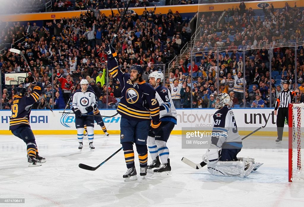 <a gi-track='captionPersonalityLinkClicked' href=/galleries/search?phrase=Matt+Moulson&family=editorial&specificpeople=3365493 ng-click='$event.stopPropagation()'>Matt Moulson</a> #26 of the Buffalo Sabres celebrates his third period goal against Ondrej Pavelec #31 of the Winnipeg Jets on December 17, 2013 at the First Niagara Center in Buffalo, New York. Buffalo won, 4-2.