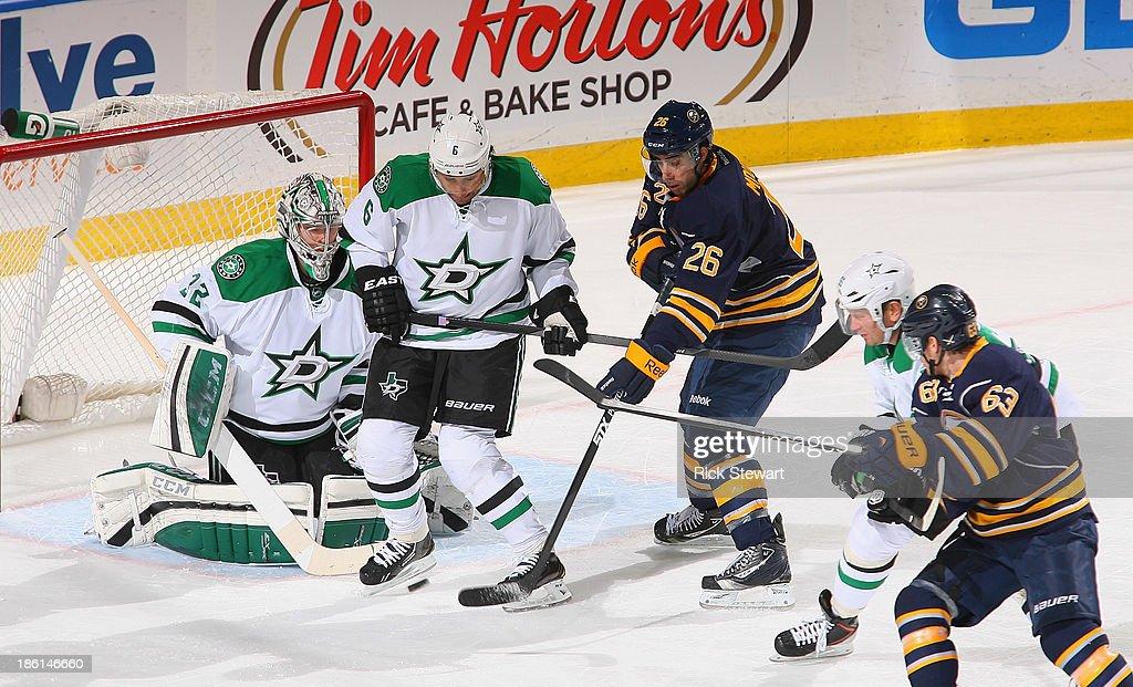 Matt Moulson #26 of the Buffalo Sabres deflects a shot toward Trevor Daley #6 and Kari Lehtonen #32 of the Dallas Stars at First Niagara Center on October 28, 2013 in Buffalo, New York.