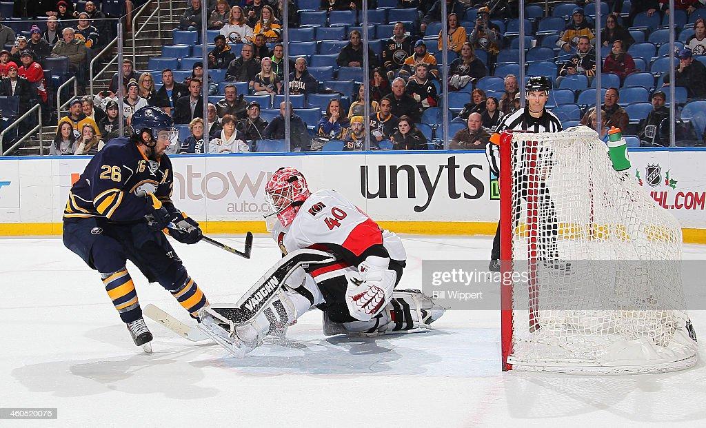 Matt Moulson of the Buffalo Sabres scores the gamewinning shootout goal against Robin Lehner of the Ottawa Senators on December 15 2014 at the First...