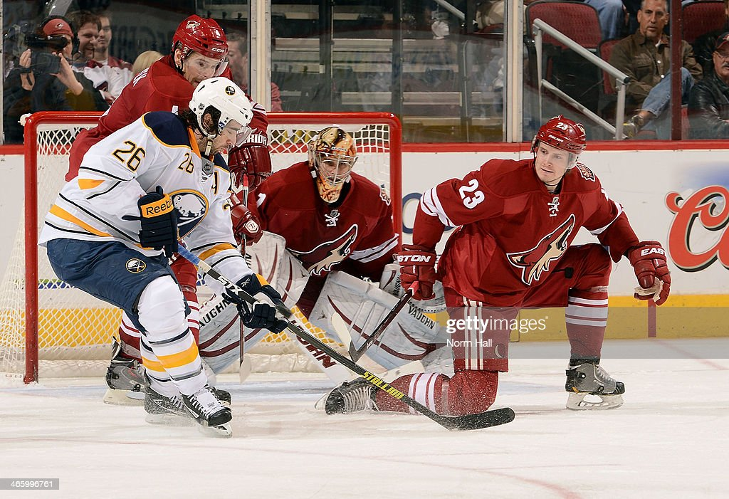 <a gi-track='captionPersonalityLinkClicked' href=/galleries/search?phrase=Matt+Moulson&family=editorial&specificpeople=3365493 ng-click='$event.stopPropagation()'>Matt Moulson</a> #26 of the Buffalo Sabres skates the puck in on goal as <a gi-track='captionPersonalityLinkClicked' href=/galleries/search?phrase=Zbynek+Michalek&family=editorial&specificpeople=243230 ng-click='$event.stopPropagation()'>Zbynek Michalek</a> #4 and <a gi-track='captionPersonalityLinkClicked' href=/galleries/search?phrase=Oliver+Ekman-Larsson&family=editorial&specificpeople=5894618 ng-click='$event.stopPropagation()'>Oliver Ekman-Larsson</a> #23 of the Phoenix Coyotes defend during the second period at Jobing.com Arena on January 30, 2014 in Glendale, Arizona.