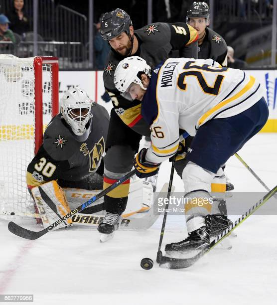 Matt Moulson of the Buffalo Sabres tries to get a shot off against Malcolm Subban and Deryk Engelland of the Vegas Golden Knights in the third period...