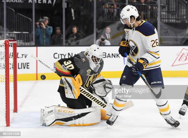 Matt Moulson of the Buffalo Sabres watches a shot by teammate Ryan O'Reilly get by for a goal against Malcolm Subban of the Vegas Golden Knights in...