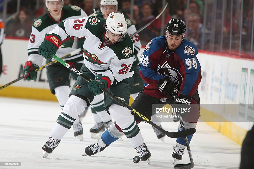 Matt Moulson #26 of the Minnesota Wild and Ryan O'Reilly #90 of the Colorado Avalanche compete for the puck in Game Two of the First Round of the 2014 Stanley Cup Playoffs at the Pepsi Center on April 19, 2014 in Denver, Colorado. The Avalanche defeated the Wild 4-2.