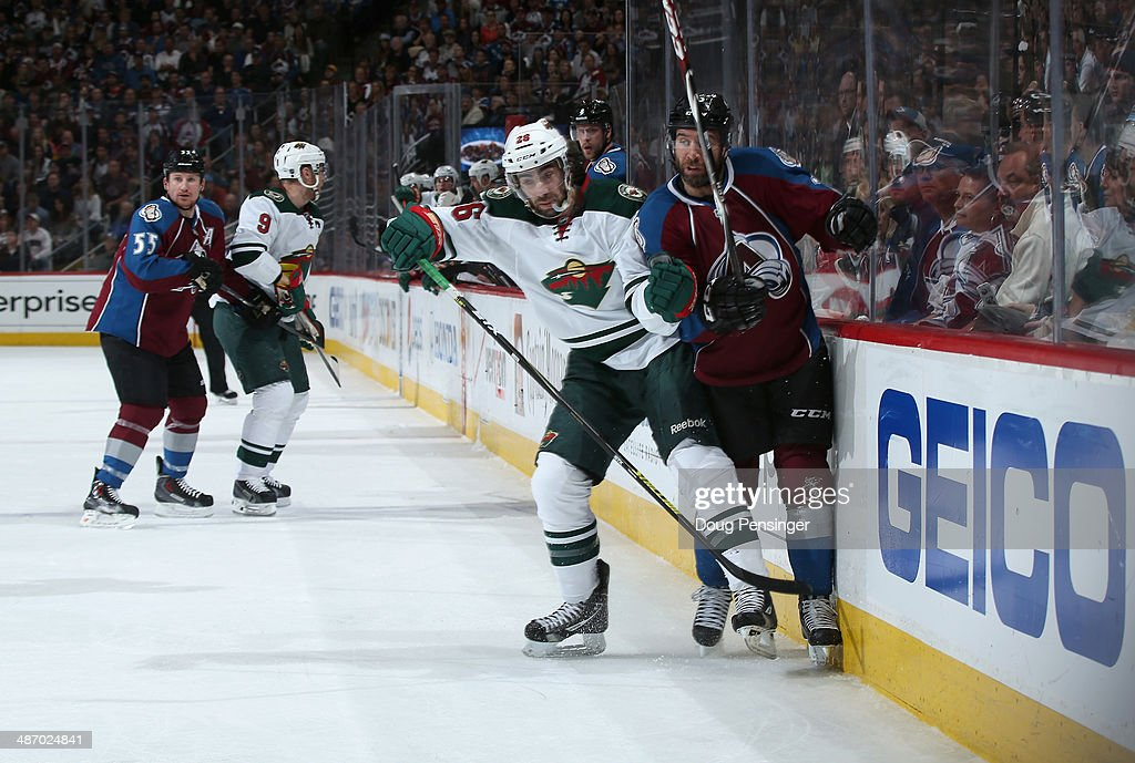 <a gi-track='captionPersonalityLinkClicked' href=/galleries/search?phrase=Matt+Moulson&family=editorial&specificpeople=3365493 ng-click='$event.stopPropagation()'>Matt Moulson</a> #26 of the Minnesota Wild puts a hit on <a gi-track='captionPersonalityLinkClicked' href=/galleries/search?phrase=Maxime+Talbot&family=editorial&specificpeople=2078922 ng-click='$event.stopPropagation()'>Maxime Talbot</a> #25 of the Colorado Avalanche in Game Five of the First Round of the 2014 NHL Stanley Cup Playoffs at Pepsi Center on April 26, 2014 in Denver, Colorado. The Avalanche defeated the Wild 4-3 in overtime to take a 3-2 game lead in the series.