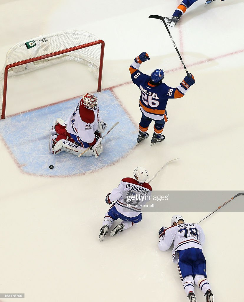<a gi-track='captionPersonalityLinkClicked' href=/galleries/search?phrase=Matt+Moulson&family=editorial&specificpeople=3365493 ng-click='$event.stopPropagation()'>Matt Moulson</a> #26 of the New York Islanders celebrates a third period goal by <a gi-track='captionPersonalityLinkClicked' href=/galleries/search?phrase=John+Tavares&family=editorial&specificpeople=601791 ng-click='$event.stopPropagation()'>John Tavares</a> #91 (not shown) against <a gi-track='captionPersonalityLinkClicked' href=/galleries/search?phrase=Carey+Price&family=editorial&specificpeople=2222083 ng-click='$event.stopPropagation()'>Carey Price</a> #31 of the Montreal Canadiens at the Nassau Veterans Memorial Coliseum on March 5, 2013 in Uniondale, New York. The Islanders defeated the Canadiens 6-3.