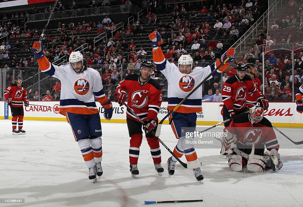 <a gi-track='captionPersonalityLinkClicked' href=/galleries/search?phrase=Matt+Moulson&family=editorial&specificpeople=3365493 ng-click='$event.stopPropagation()'>Matt Moulson</a> #26 of the New York Islanders (L) celebrates his first period goal against the New Jersey Devils along with <a gi-track='captionPersonalityLinkClicked' href=/galleries/search?phrase=P.A.+Parenteau&family=editorial&specificpeople=5537244 ng-click='$event.stopPropagation()'>P.A. Parenteau</a> #15 (R) at the Prudential Center on April 3, 2012 in Newark, New Jersey.