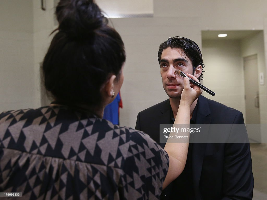 <a gi-track='captionPersonalityLinkClicked' href=/galleries/search?phrase=Matt+Moulson&family=editorial&specificpeople=3365493 ng-click='$event.stopPropagation()'>Matt Moulson</a> of the New York Islanders gets prepared for a portrait session during the National Hockey League Player Media Tour at the Prudential Center on September 6, 2013 in Newark, New Jersey.