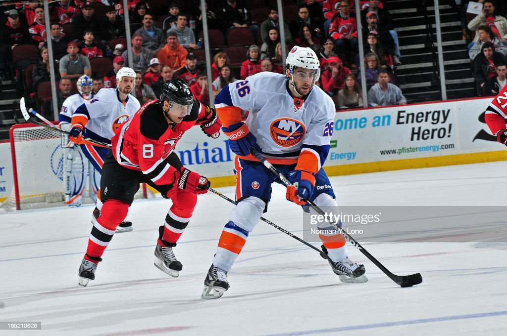 <a gi-track='captionPersonalityLinkClicked' href=/galleries/search?phrase=Matt+Moulson&family=editorial&specificpeople=3365493 ng-click='$event.stopPropagation()'>Matt Moulson</a> #26 of the New York Islanders is being chased by <a gi-track='captionPersonalityLinkClicked' href=/galleries/search?phrase=Dainius+Zubrus&family=editorial&specificpeople=204779 ng-click='$event.stopPropagation()'>Dainius Zubrus</a> #8 of the New Jersey Devils at the Prudential Center on April 1, 2013 in Newark, New Jersey. Islanders win 3-1 over the Devils.