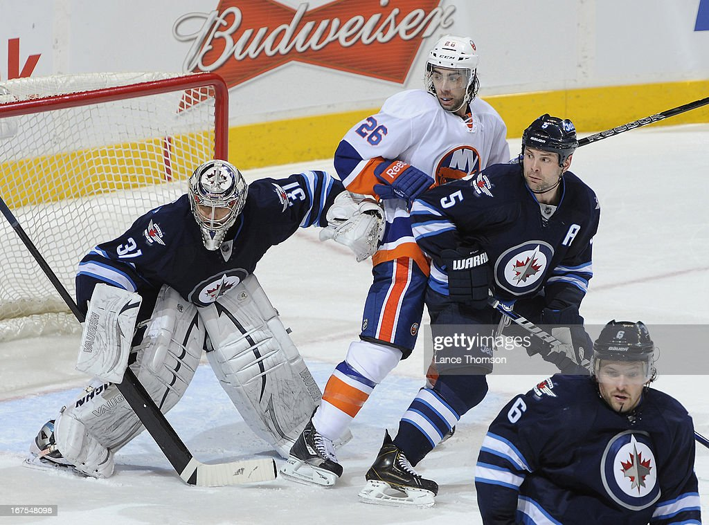 <a gi-track='captionPersonalityLinkClicked' href=/galleries/search?phrase=Matt+Moulson&family=editorial&specificpeople=3365493 ng-click='$event.stopPropagation()'>Matt Moulson</a> #26 of the New York Islanders positions himself between goaltender Ondrej Pavelec #31 and Mark Stuart #5 of the Winnipeg Jets during second period action at the MTS Centre on April 20, 2013 in Winnipeg, Manitoba, Canada. The Isles defeated the Jets 5-4 in a shootout.