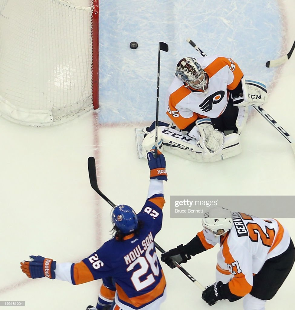<a gi-track='captionPersonalityLinkClicked' href=/galleries/search?phrase=Matt+Moulson&family=editorial&specificpeople=3365493 ng-click='$event.stopPropagation()'>Matt Moulson</a> #26 of the New York Islanders scores at 15:36 of the first period against Steve Mason #35 of the Philadelphia Flyers at the Nassau Veterans Memorial Coliseum on April 9, 2013 in Uniondale, New York. The Islanders defeated the Flyers 4-1.
