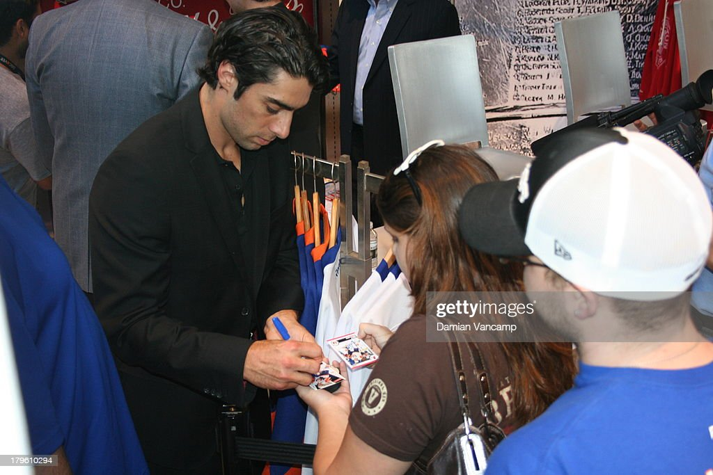 Matt Moulson #26 of the New York Islanders signs autographs after a live interview in front of fans at the NHL Store Powered by Reebok on September 5, 2013 in New York City.
