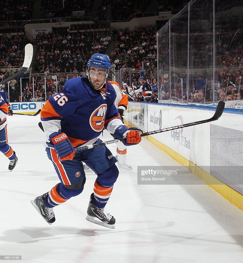 Matt Moulson #26 of the New York Islanders skates against the Philadelphia Flyers at the Nassau Veterans Memorial Coliseum on April 9, 2013 in Uniondale, New York. The Islanders defeated the Flyers 4-1.