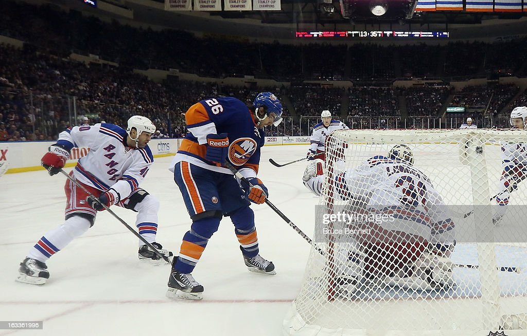 <a gi-track='captionPersonalityLinkClicked' href=/galleries/search?phrase=Matt+Moulson&family=editorial&specificpeople=3365493 ng-click='$event.stopPropagation()'>Matt Moulson</a> #26 of the New York Islanders skates against the New York Rangers at the Nassau Veterans Memorial Coliseum on March 7, 2013 in Uniondale, New York. The Rangers defeated the Islanders 2-1 in overtime.