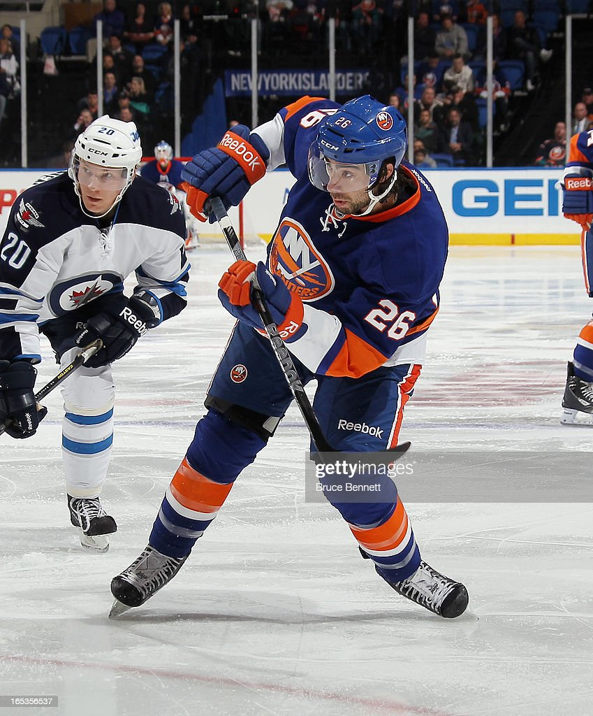 Matt Moulson #26 of the New York Islanders skates against the Winnipeg Jets at the Nassau Veterans Memorial Coliseum on April 2, 2013 in Uniondale, New York. The Islanders defeated the Jets 5-2.
