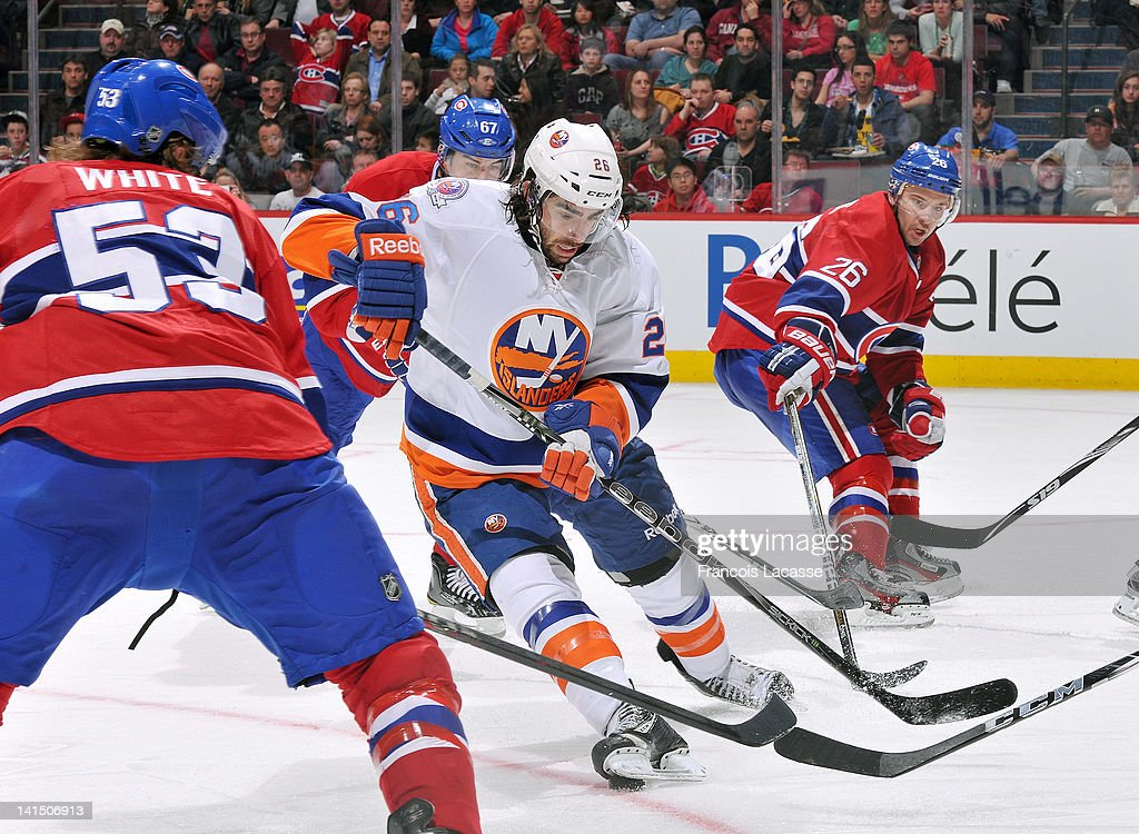 <a gi-track='captionPersonalityLinkClicked' href=/galleries/search?phrase=Matt+Moulson&family=editorial&specificpeople=3365493 ng-click='$event.stopPropagation()'>Matt Moulson</a> #26 of the New York Islanders tries to carry the puck past <a gi-track='captionPersonalityLinkClicked' href=/galleries/search?phrase=Ryan+White+-+Ice+Hockey+Player&family=editorial&specificpeople=16069622 ng-click='$event.stopPropagation()'>Ryan White</a> #53 and <a gi-track='captionPersonalityLinkClicked' href=/galleries/search?phrase=Josh+Gorges&family=editorial&specificpeople=550446 ng-click='$event.stopPropagation()'>Josh Gorges</a> #26 during the NHL game on March 17, 2012 at the Bell Centre in Montreal, Quebec, Canada.
