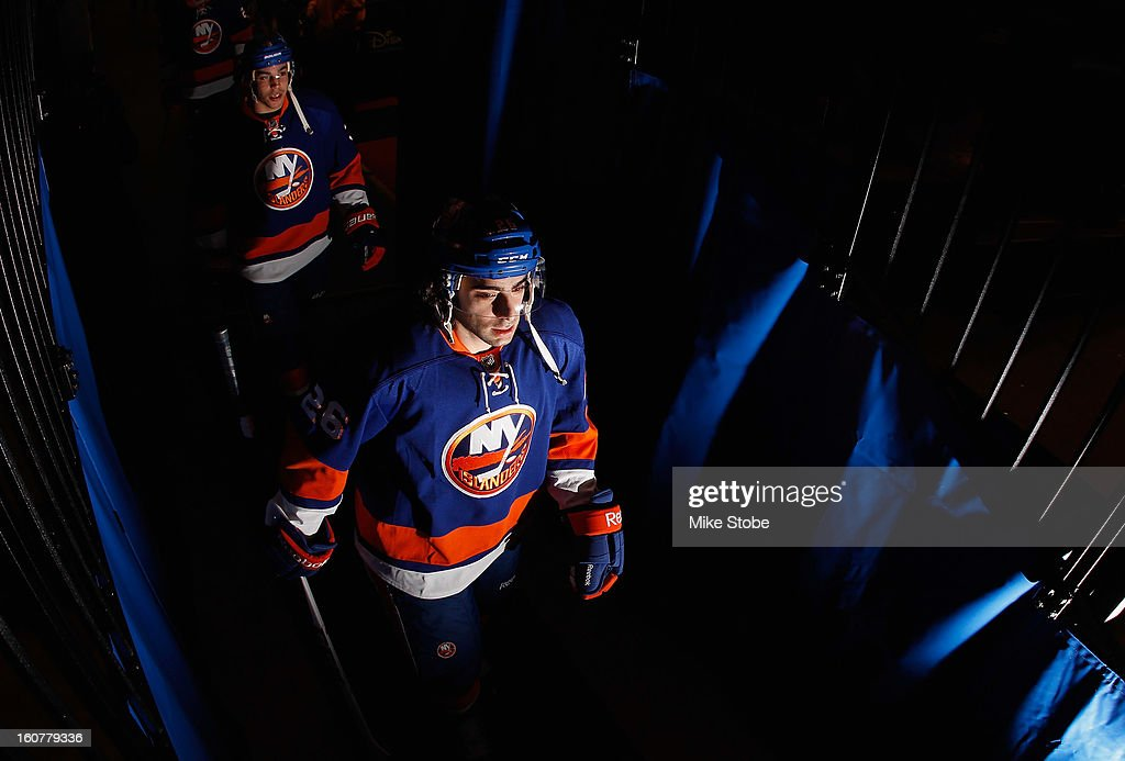 Matt Moulson #26 of the New York Islanders walks onto the ice for warm ups prior to the game against the Pittsburgh Penguins at Nassau Veterans Memorial Coliseum on Febuary 5, 2013 in Uniondale, New York.