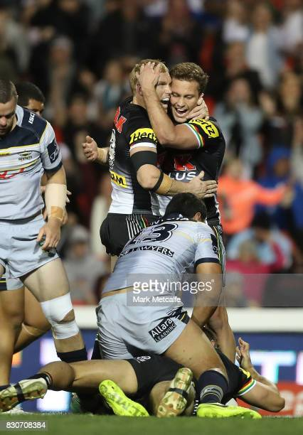 Matt Moylan and Peter Wallace of the Panthers celebrate a try by James Tamou of the Panthers during the round 23 NRL match between the Penrith...