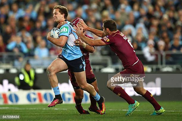 Matt Moylan of the Blues is tackled during game three of the State Of Origin series between the New South Wales Blues and the Queensland Maroons at...