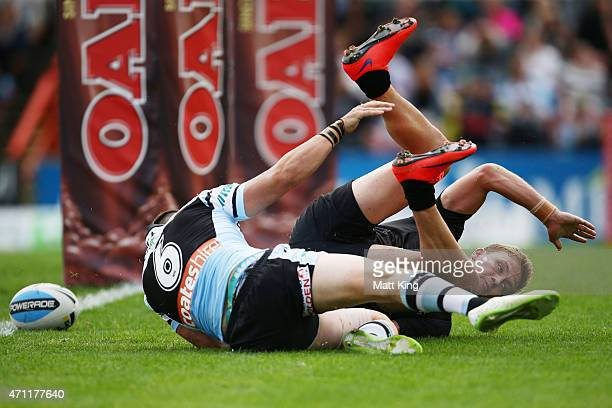 Matt Moylan of the Panthers beats Jack Bird of the Sharks to score a try during the round eight NRL match between the Penrith Panthers and the...