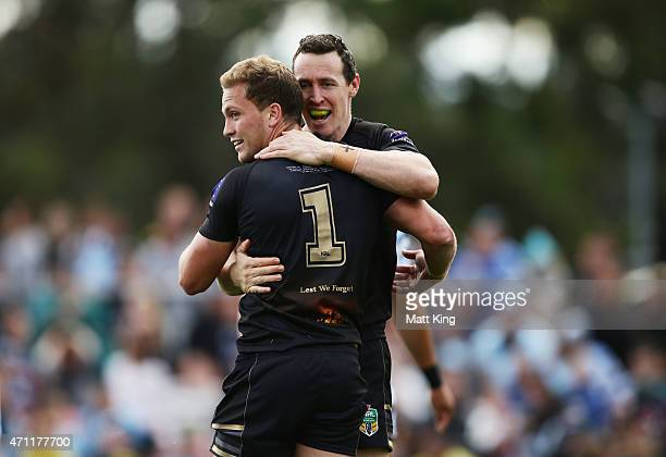 Matt Moylan of the Panthers celebrates with David Simmons after scoring a try during the round eight NRL match between the Penrith Panthers and the...