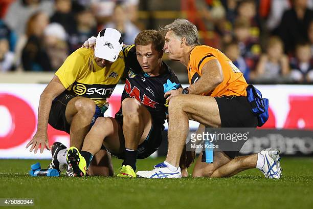 Matt Moylan of the Panthers is helped to his feet before leaving the field with an injury during the round 12 NRL match between Penrith Panthers and...