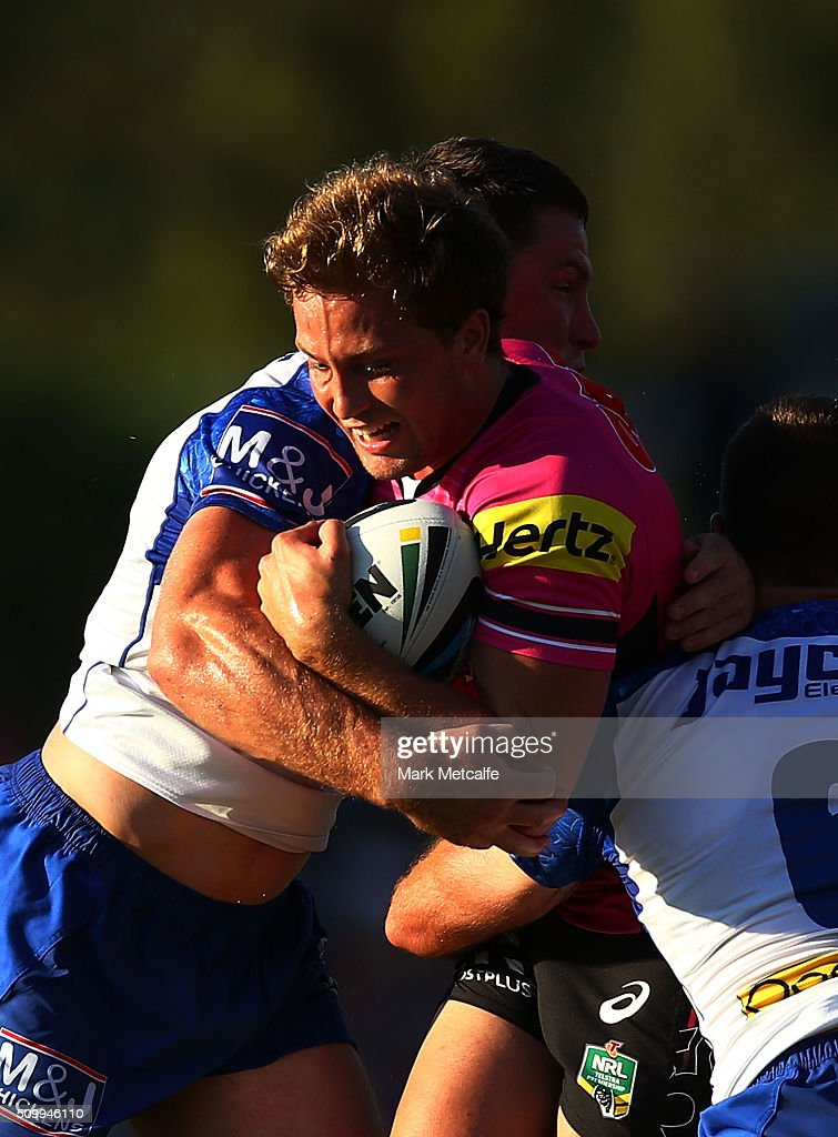 Matt Moylan of the Panthers is tackled during the NRL Trial match between the Canterbury Bulldogs and the Penrith Panthers at Pepper Stadium on February 13, 2016 in Sydney, Australia.
