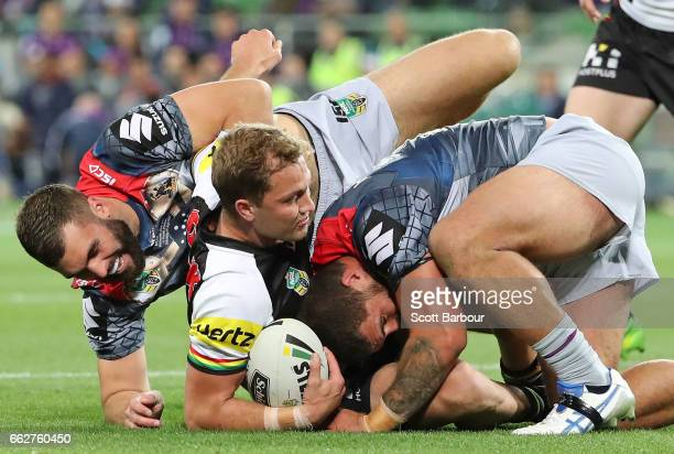 Matt Moylan of the Panthers is tackled during the round five NRL match between the Melbourne Storm and the Penrith Panthers at AAMI Park on April 1...