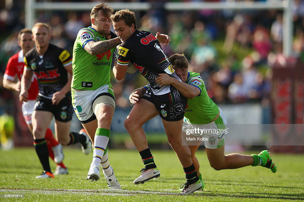 Matt Moylan of the Panthers is tackled during the round nine NRL match between the Penrith Panthers and the Canberra Raiders at Carrington Park on April 30, 2016 in Bathurst, Australia.