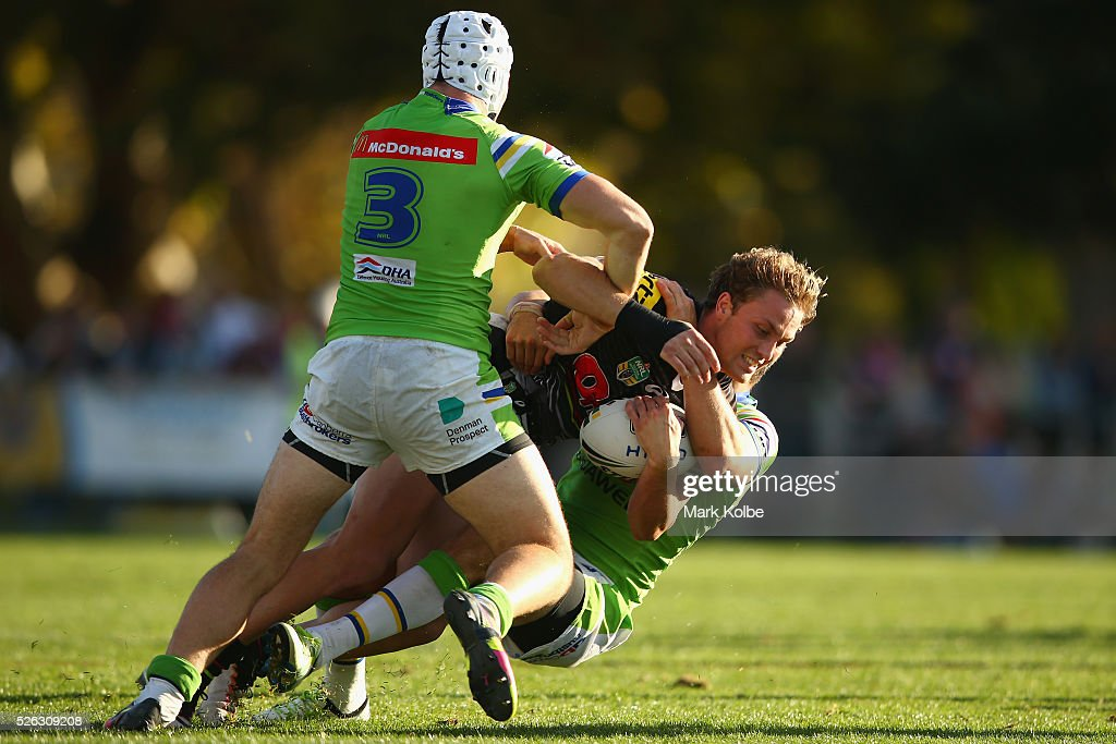 <a gi-track='captionPersonalityLinkClicked' href=/galleries/search?phrase=Matt+Moylan&family=editorial&specificpeople=10892874 ng-click='$event.stopPropagation()'>Matt Moylan</a> of the Panthers is tackled during the round nine NRL match between the Penrith Panthers and the Canberra Raiders at Carrington Park on April 30, 2016 in Bathurst, Australia.