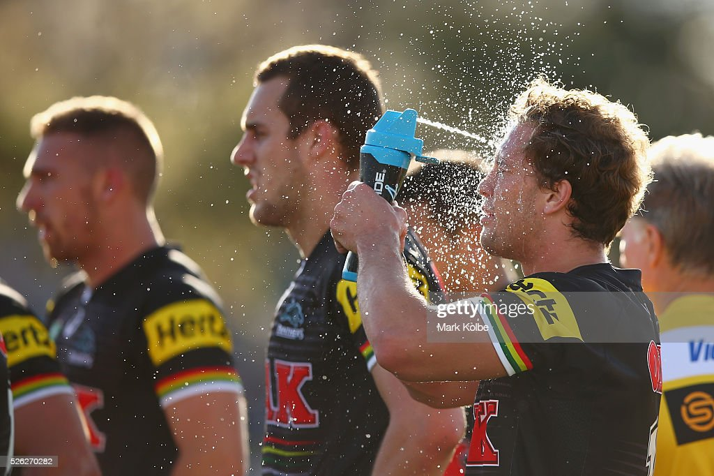 <a gi-track='captionPersonalityLinkClicked' href=/galleries/search?phrase=Matt+Moylan&family=editorial&specificpeople=10892874 ng-click='$event.stopPropagation()'>Matt Moylan</a> of the Panthers sprays water on his face to cool down during the round nine NRL match between the Penrith Panthers and the Canberra Raiders at Carrington Park on April 30, 2016 in Bathurst, Australia.