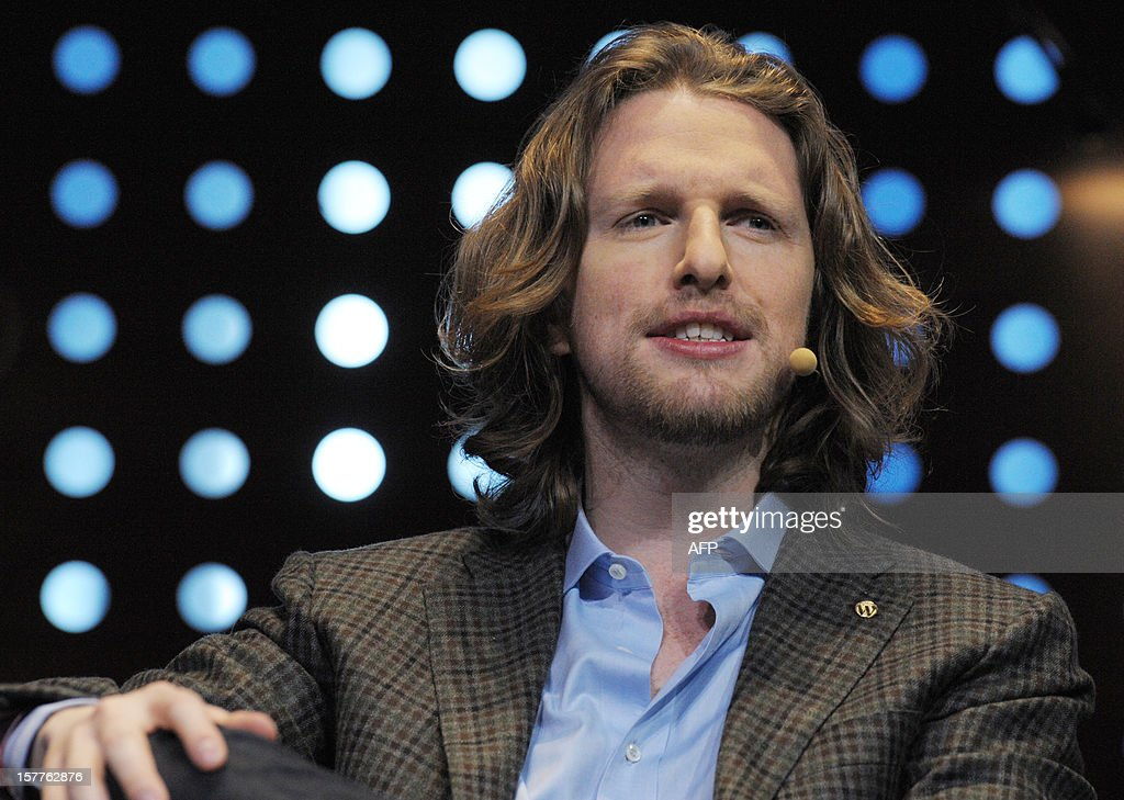 Matt Mullenweg, founder of web development corporation Automattic and Om Malik who also developped the free and open source web software, WordPress takes part in a jury for a Start-Up Competition during LeWeb conference in Saint-Denis, near Paris on December 6, 2012. Le Web is Europe's largest tech conference, bringing together the entrepreneurs, leaders and influencers who shape the future of the internet. AFP PHOTO ERIC PIERMONT