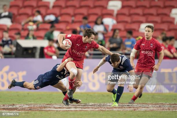 Matt Mullins of Canada runs with the ball while American players try to stop him during the match United States vs Canada the Cup Final of the HSBC...