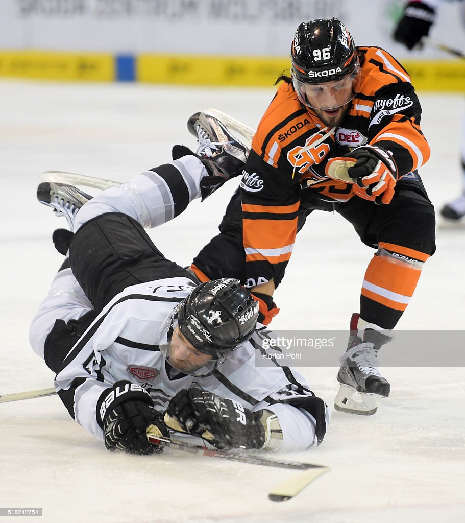 Matt Murley of the Thomas Sabo Ice Tigers Nuernberg and André Reiss of the Grizzlys Wolfsburg during the game between the Grizzlys Wolfsburg and...