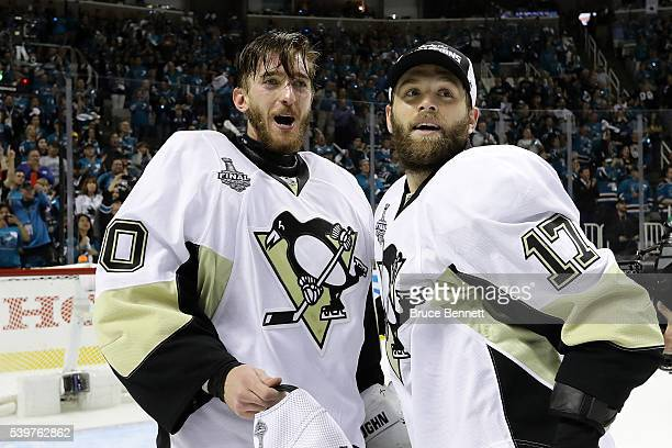 Matt Murray and Bryan Rust of the Pittsburgh Penguins look on as their team celebrate their 31 victory to win the Stanley Cup against the San Jose...