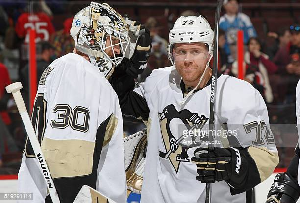Matt Murray and Patric Hornqvist of the Pittsburgh Penguins celebrate their win over the Ottawa Senators at Canadian Tire Centre on April 5 2016 in...