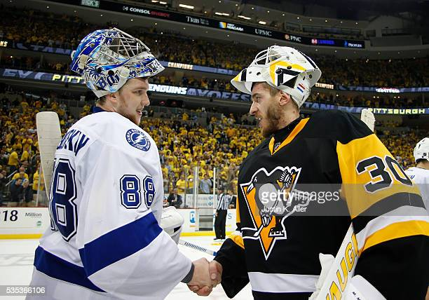 Matt Murray of the Pittsburgh Penguins and Andrei Vasilevskiy of the Tampa Bay Lightning shake hands in Game Seven of the Eastern Conference Final...