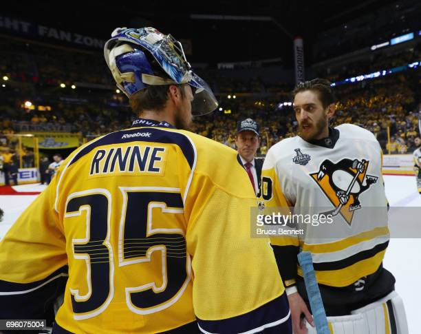 Matt Murray of the Pittsburgh Penguins and Pekka Rinne of the Nashville Predators shake hands following the Penguins Stanley Cup winning victory over...