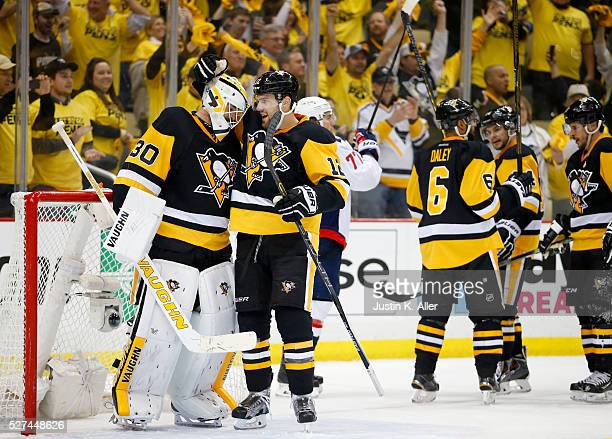 Matt Murray of the Pittsburgh Penguins celebrates with Ben Lovejoy after defeating the Washington Capitals 32 in Game Three of the Eastern Conference...