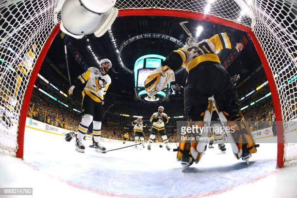 Matt Murray of the Pittsburgh Penguins celebrates with Brian Dumoulin after they defeated the Nashville Predators 20 in Game Six of the 2017 NHL...