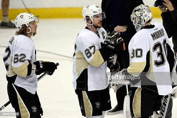 Matt Murray of the Pittsburgh Penguins celebrates with his teammates Sidney Crosby and Carl Hagelin after defeating the Tampa Bay Lightning in Game...