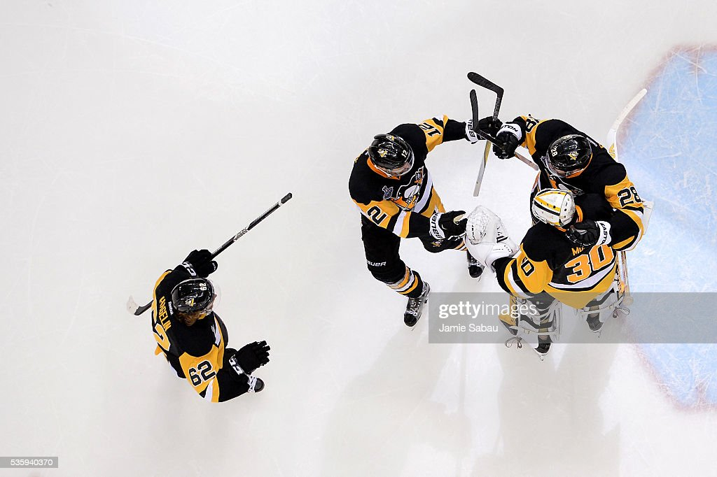 <a gi-track='captionPersonalityLinkClicked' href=/galleries/search?phrase=Matt+Murray+-+Ice+Hockey+Player&family=editorial&specificpeople=15609595 ng-click='$event.stopPropagation()'>Matt Murray</a> #30 of the Pittsburgh Penguins celebrates with <a gi-track='captionPersonalityLinkClicked' href=/galleries/search?phrase=Ian+Cole&family=editorial&specificpeople=4361308 ng-click='$event.stopPropagation()'>Ian Cole</a> #28, <a gi-track='captionPersonalityLinkClicked' href=/galleries/search?phrase=Ben+Lovejoy&family=editorial&specificpeople=4509565 ng-click='$event.stopPropagation()'>Ben Lovejoy</a> #12, and <a gi-track='captionPersonalityLinkClicked' href=/galleries/search?phrase=Carl+Hagelin&family=editorial&specificpeople=4465394 ng-click='$event.stopPropagation()'>Carl Hagelin</a> #62 after defeating the San Jose Sharks 3-2 in Game One of the 2016 NHL Stanley Cup Final at Consol Energy Center on May 30, 2016 in Pittsburgh, Pennsylvania.