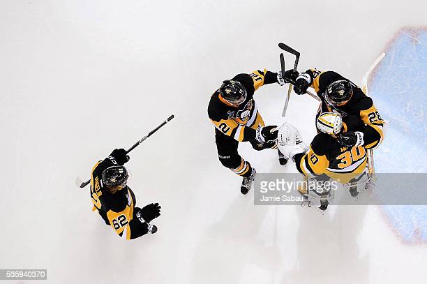Matt Murray of the Pittsburgh Penguins celebrates with Ian Cole Ben Lovejoy and Carl Hagelin after defeating the San Jose Sharks 32 in Game One of...