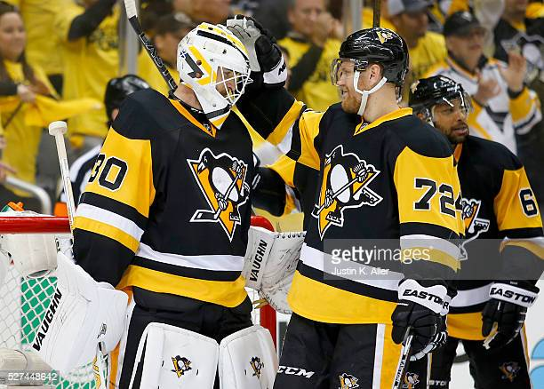 Matt Murray of the Pittsburgh Penguins celebrates with Patric Hornqvist after defeating the Washington Capitals 32 in Game Three of the Eastern...