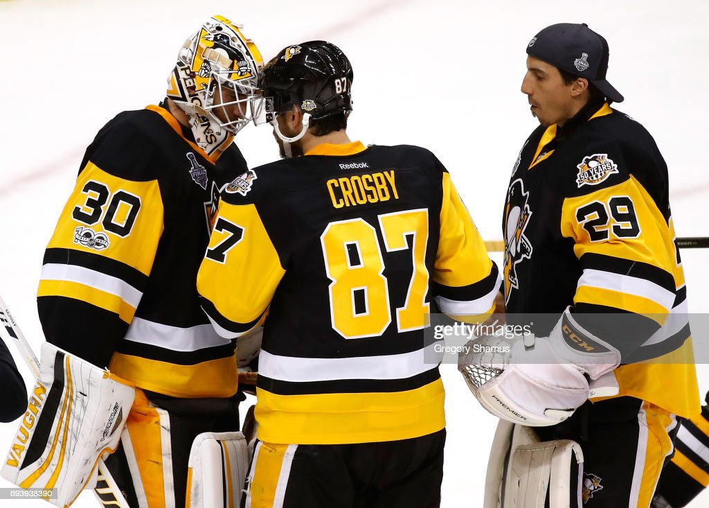 Matt Murray #30 of the Pittsburgh Penguins celebrates with Sidney Crosby #87 after defeating the Nashville Predators in Game Five of the 2017 NHL Stanley Cup Final at PPG PAINTS Arena on June 8, 2017 in Pittsburgh, Pennsylvania.