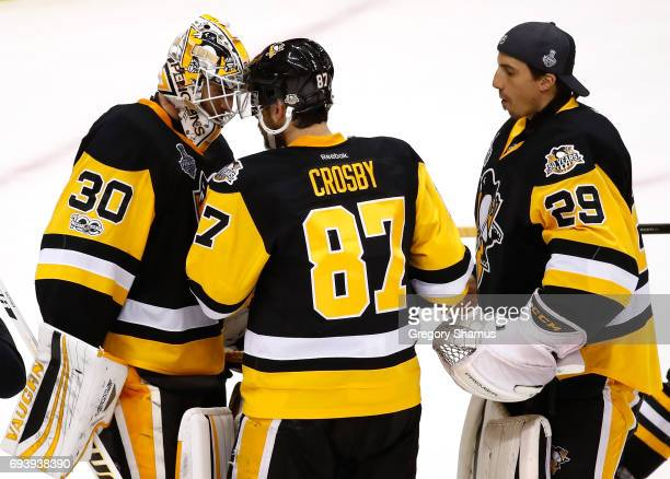 Matt Murray of the Pittsburgh Penguins celebrates with Sidney Crosby after defeating the Nashville Predators in Game Five of the 2017 NHL Stanley Cup...