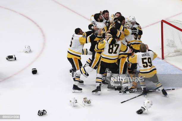 Matt Murray of the Pittsburgh Penguins celebrates with teammates after they defeated the Nashville Predators 20 to win the 2017 NHL Stanley Cup Final...
